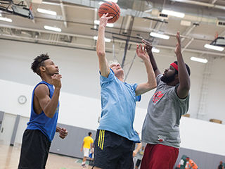 Vice President of Student Affairs Mark Kelly throws up a hook shot during the Nov. 13 3-on-3 Renegades basketball tournament at the Goodman Center.