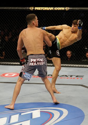 Josh Thomson kicks Nate Diaz in their lightweight bout during the UFC on FOX event at the HP Pavilion on April 20, 2013 in San Jose, California.
