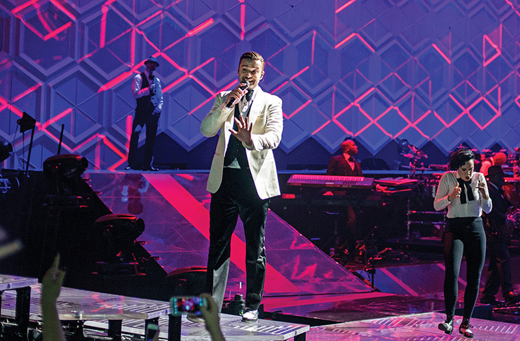 Justin Timberlake hustles across the stage while performing the hit