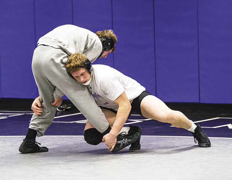 Northwestern heavyweight wrestler Mike McMullan practices with 184 lb wrestler Jacob Berkowitz at Anderson Hall on Thursday, February 6th.