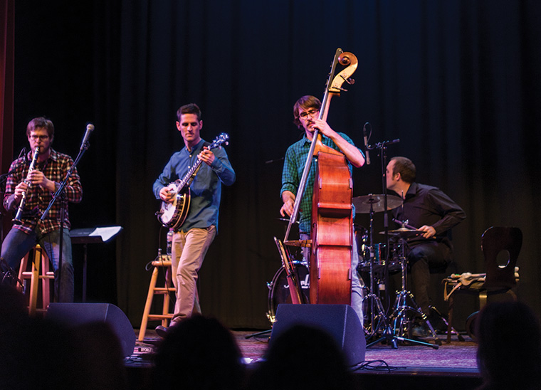 Andrew Small (middle) studied music at Yale University and is now touring with Jayme Stone.