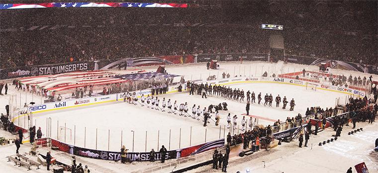 The crowd cheers March 1 as the National Anthem is played before the Chicago Blackhawks and Pittsburgh Penguins face off at Solider Field.