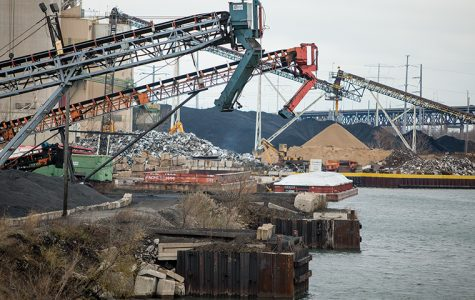 KCBX Terminals Co. stores stockpiles of petroleum coke on the banks of the Calumet River on the Southeast Side. KCBX must fully enclose its stockpiles within two years under regulation imposed March 13 by Mayor Rahm Emanuel.