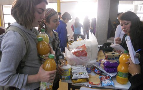 Lauren Keeling, junior art + design major, and Ameena Igram, junior communications major at DePaul University, donate food to displaced residents in Valparaiso, Chile.  A forest fire spread through the hills, forcing thousands of residents to evacuate their homes.