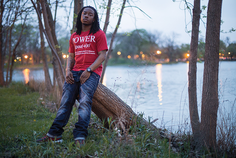 Chicago rapper Fly Fresh poses in Garfield Park near where he grew up. He began identifying with the One-Way Four Corner Hustlers, a 4CH faction aligned with other gangs in the One-Way alliance, at 8 years old. Fly Fresh, now 24, said he no longer gangbangs but still claims the gang because it's simply a way of life on Chicago's West Side.