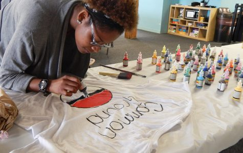 Michelle Nance, the president of Common Ground, Columbia's LGBTQ student organization, decorates a T-shirt for the June 29 Gay Pride Parade in Chicago in preparation for Common Ground's participation in the event.