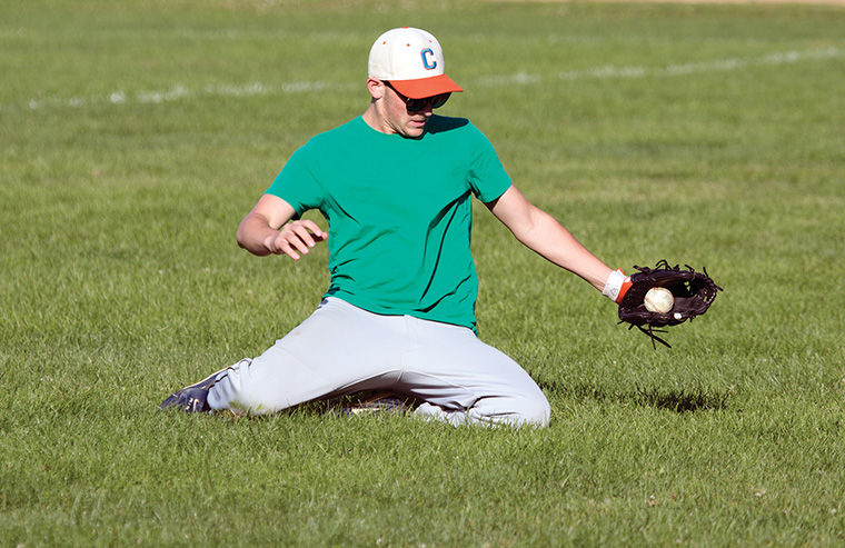 Toby Pechner, a junior marketing communication major, makes a sliding catch in the field at one of the team's daily practices at Dunbar Park, 300 E. 31st St.