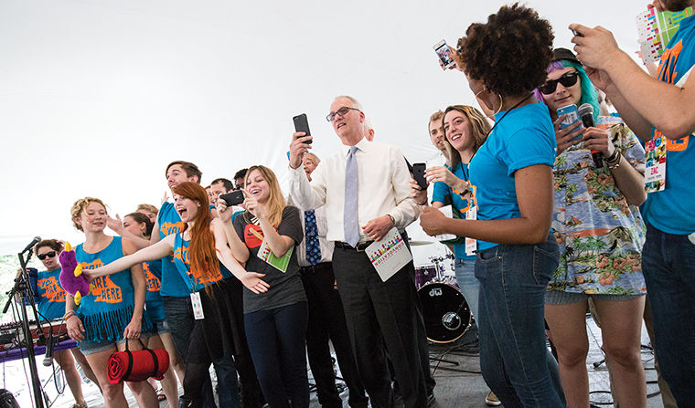 Stan Wearden, senior vice president and provost, takes selfie with incoming students at Convocation.
