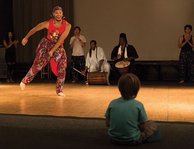 Student does african dance during WAC Crawl