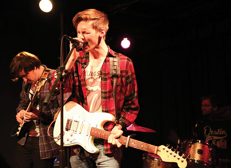 Mike Fornari (left) and Caleb Hiltunen (right) perform with Friday Pilot's Club on Oct. 8 at Rock Against Rape.