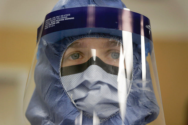 In this Oct. 16, 2014, file photo, Registered nurse Keene Roadman, stands fully dressed in personal protective equipment during a training class at the Rush University Medical Center, in Chicago. The Centers for Disease Control and Prevention released new guidelines Monday, Oct. 20, for how health workers should gear up to treat Ebola patients. (AP Photo/Charles Rex Arbogast, File) ASSOCIATED PRESS