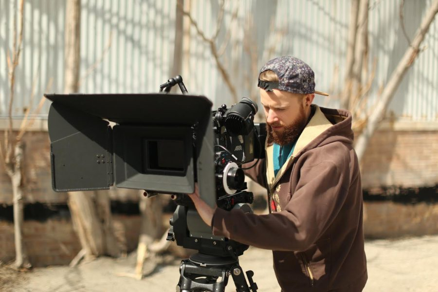 Nick Puetz, co-founder, president and director of photography for Pink Hippo Productions operates one of the company's cameras during production.