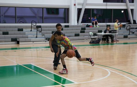 Justin Eddings, a freshman cinema art + science major, drives past defender Louis Lloyd, a freshman audio arts & acoustics major, to the basket in the first round of the tournament.