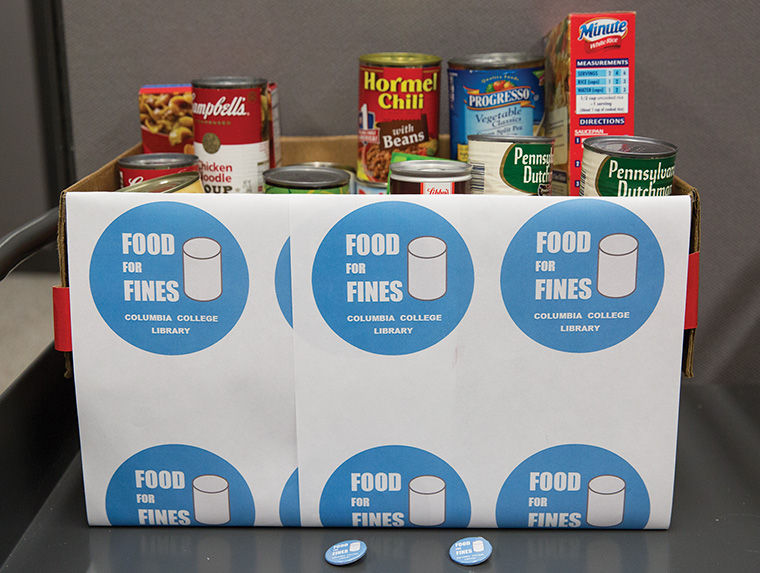 A+box+had+already+been+filled+with+non-perishable+goods+donated+by+students+during+the+first+stretch+of+the+Library%E2%80%99s+Food+For+Fines+campaign%2C+a+program+to+collect+food+for+nonprofit+organization+Chicago+Lights+in+exchange+for+late+fee+credit.%C2%A0