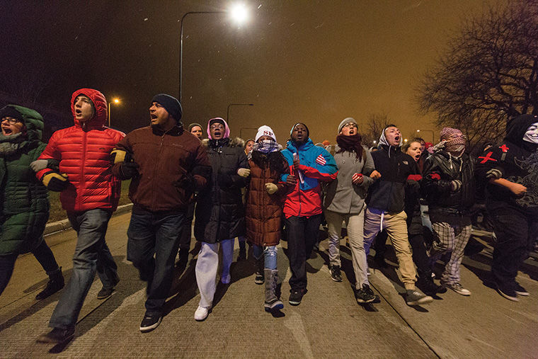"Demonstrators head north on Lake Shore Drive shouting ""we shut sh-- down"" as they march unified in disapproval of the decision to not indict Ferguson police officer Darren Wilson."