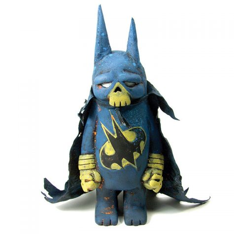 "The ""Bat Bear,"" a customized vinyl bear champ toy, is a collaboration between artists JC Rivera and Leecifer. customized vinyl Bear Champ toy"