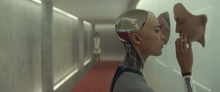 """Oscar Isaac and Alicia Vikander star in """"Ex Machina,"""" a film about a programmer who takes part in an experiment with a female robot who takes on human-like qualities."""