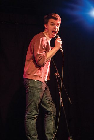 "Ethan Burk, a junior theatre major, expresses his hate for celebrating birthdays on April 11 during ""Wise Ass,"" the college's comedy night series hosted at the HAUS in the 623 S. Wabash Ave. Building."