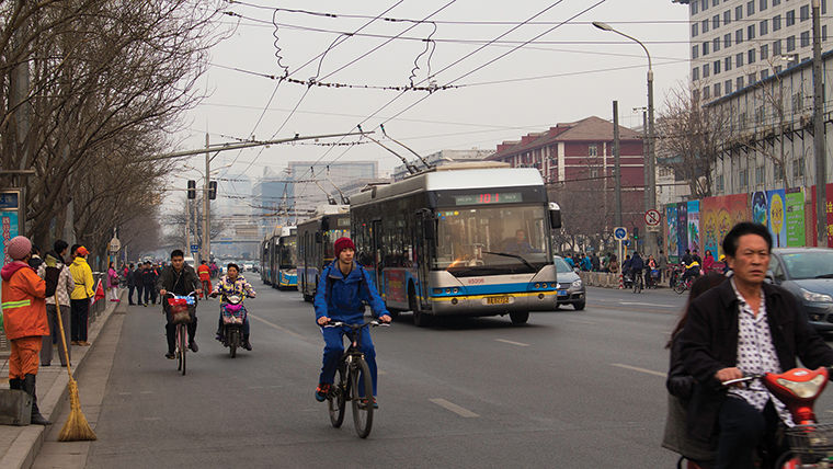 Outside of downtown Beijing, students experience how heavy rush hour traffic contributes to pollution and smog.