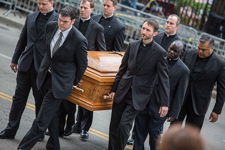 Pallbearers carry Cardinal Francis George's casket on April 23 at Holy Name Cathedral, 735 N. State St. He was later buried at All Saints Cemetery in Des Plaines, Illinois.