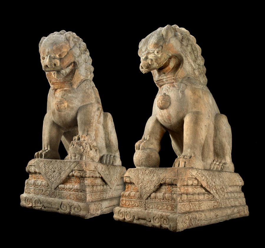 Statues of guardian lions traditionally stood in front of Chinese imperial buildings and temples, as well as the homes of government officials and the wealthy, and were believed to have powerful protective benefits. The male leans his right paw upon an embroidered ball (in imperial contexts, representing supremacy over the world) and the female nurtures a cub under her left paw.
