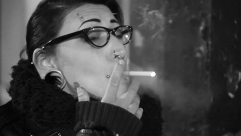 """Eve Studnicka's """"The Night Smokers of Chicago"""" chronicles a motley cast of strangers found smoking cigarettes on the streets of Chicago."""