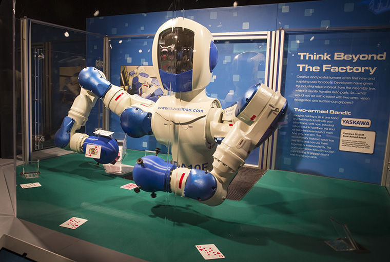 Yasakawa Robotic21 System used suction cups on its arms to deal cards and play blackjack against museum guests.