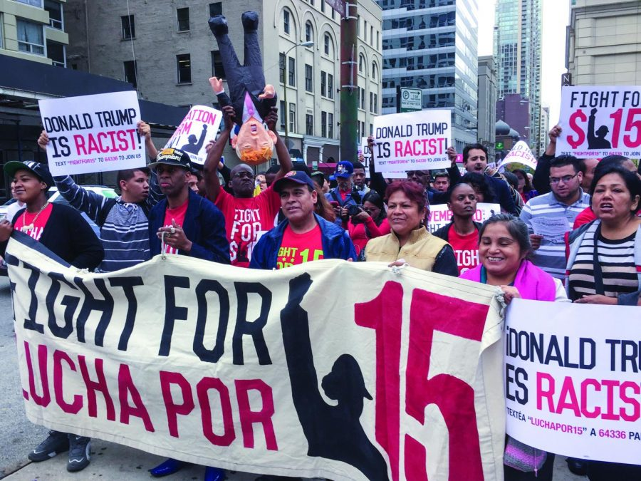 Protesters unhappy with Trump's presidential campaign held signs and carried a Donald Trump piñata as they marched to the Trump Tower.