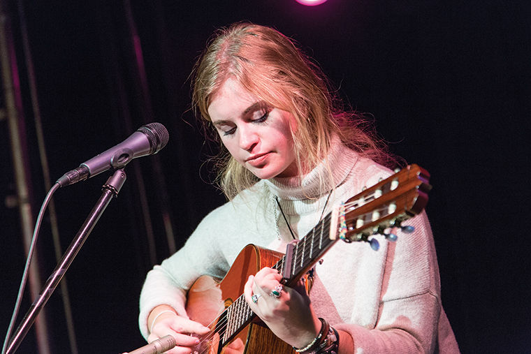 Leah Griffith, a sophomore music major, performs during WAC's Acoustic Kitchen event at HAUS inside the 623 S. Wabash Ave. Building.