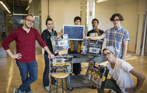 Students in a product design class display a collaborative project using solar energy that they have been working on with the Science & Mathematics Department.