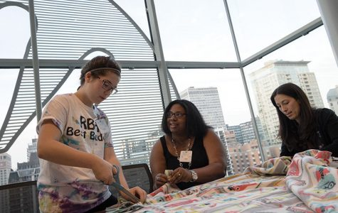 From left, Maggie Greenlees, Kishá Jones and Julie Sollinger made blankets on Oct. 21 for Robert H. Lurie Children's Hospital patients during an event honoring co-workers who died in a 2003 fire.