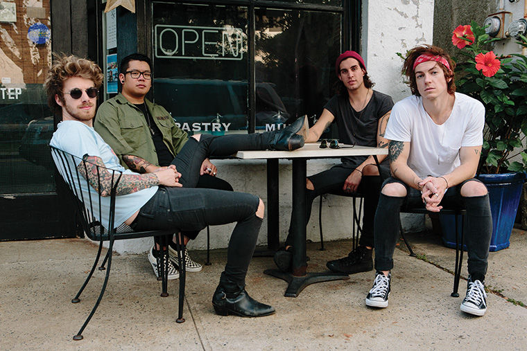 Young Rising Sons lead singer, Andy Tongren (right), said guitarist Dylan Scott (left) came up with the name for the band when he was at Disney's Magic Kingdom.
