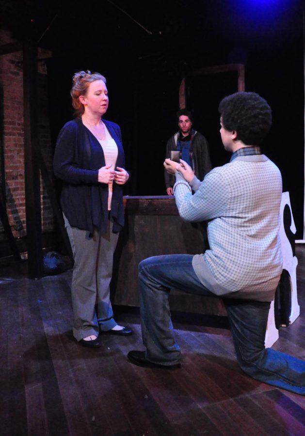 "Jonas (Dan Cobbler) proposes to Hope (Pamela Mae Davis) in ""Fugue"" as Christopher (Noah Laufer) looks on."
