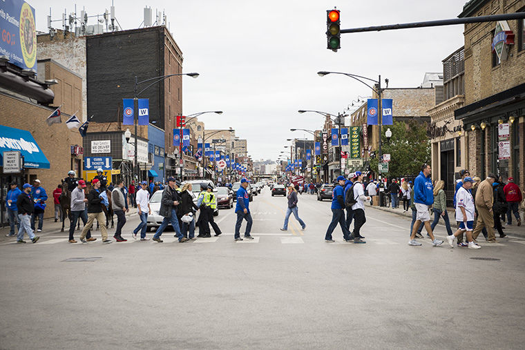 Fans make their way to Wrigley Field to watch the Cubs and the Cardinals play Tuesday Oct. 13.