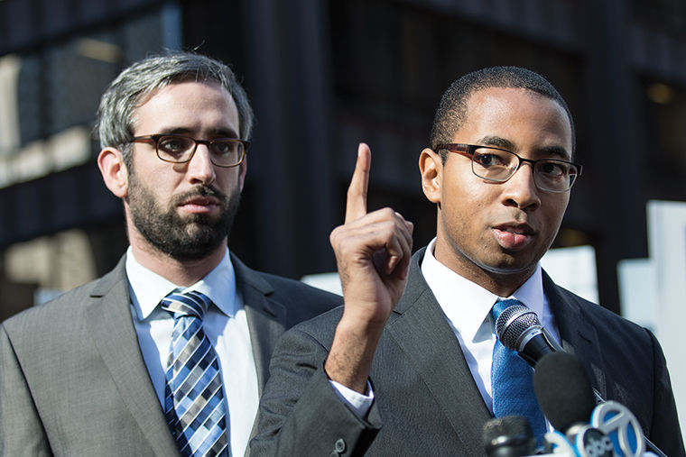 (From left) State Representatives Will Guzzardi and Christian Mitchell called on Gov. Bruce Rauner to eliminate tax breaks for the wealthy before a Nov. 2 protest.