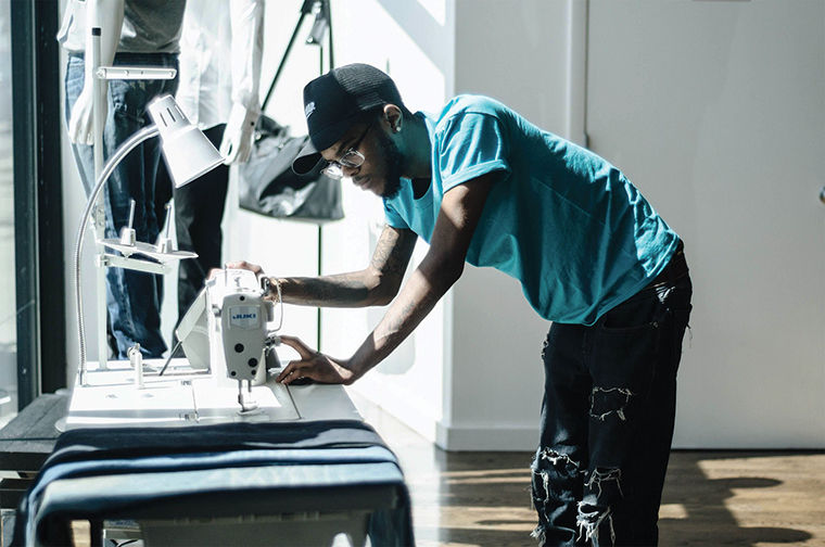 Ron Louis, a 22-year-old fashion designer from Chicago, works on upcoming work.