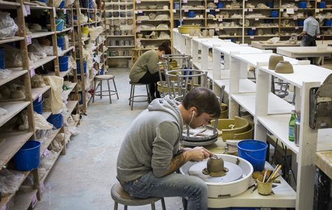 Artists work on pottery wheels in Lillstreet's ceramic workspace