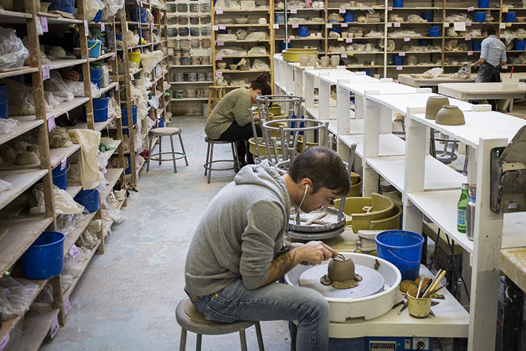 Artists work on pottery wheels in Lillstreets ceramic workspace