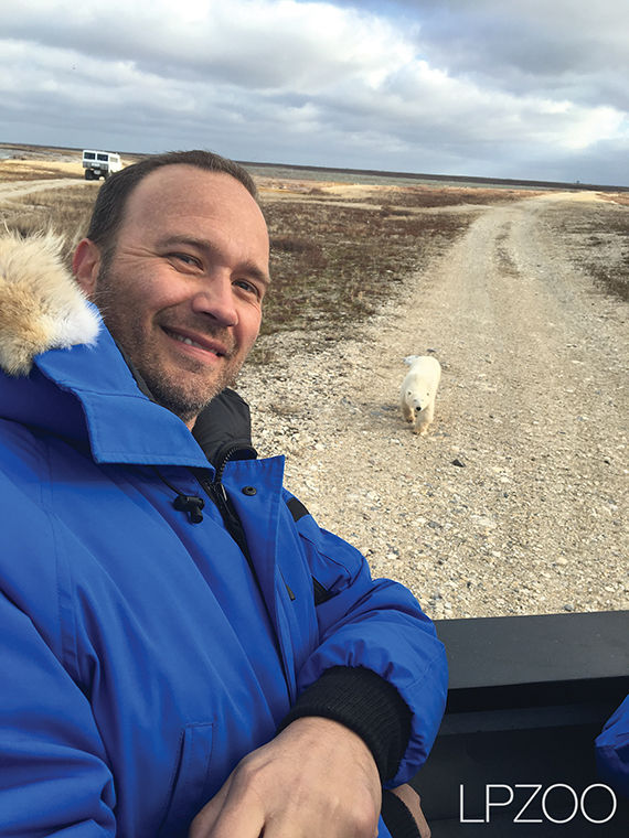Nielsen poses for a picture with a polar bear on his trip with Polar Bears  International's Climate Alliance.