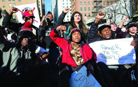 Following Mayor Rahm Emanuel's apology at City Hall on Dec 9, several hundred protesters marched through the Loop, demanding the mayor's resignation.
