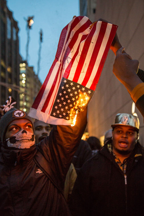 Protesters burned an American flag during a demonstration calling for the resignation of Mayor Rahm Emanuel, Cook County State's Attorney Anita Alvarez and Gov. Bruce Rauner Feb. 23.