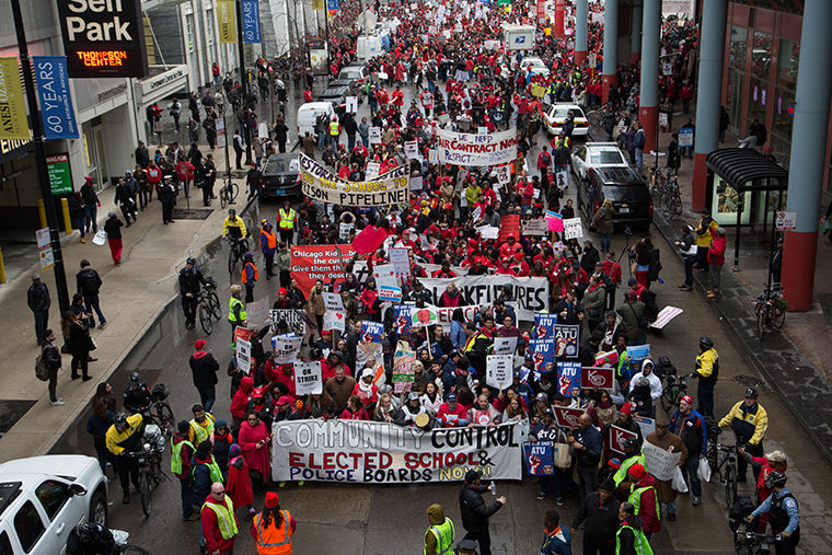 CTU members and supporters (left) protested to call attention to the lack of funding for CPS.