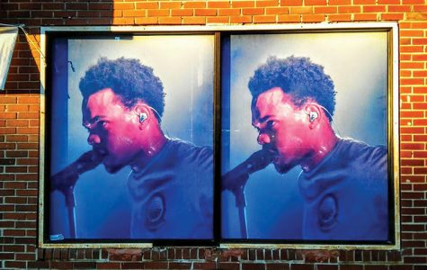 Paintings of Chance the Rapper and Common are plastered on buildings on 79th and Evans streets in the Chatham neighborhood to boost positive imaging.