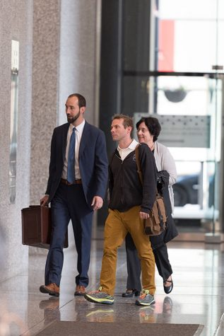 Attorney Michael Persoon (Left) along with Nic Ruly (center) and part-time faculty union president Diana Vallera enter the Dirksen Federal Building 219 S. Dearborn St., Suite 808 on May 18 for a hearing regarding a dispute between P-Fac and full-time staff members who teach part-time.