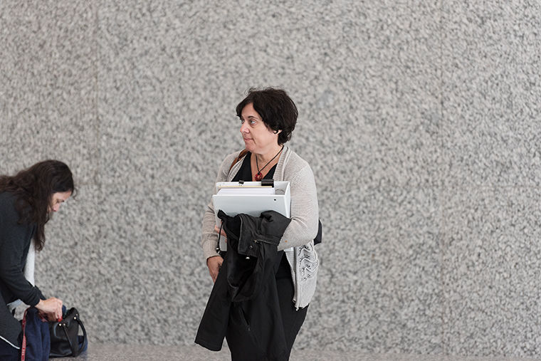 Part-time faculty union President Diana Vallera enters the Everett McKinley Dirksen United States Courthouse, 219 S. Dearborn St., May 18 for an ongoing National Labor Relations Board hearing regarding full-time staff members' eligibility to teach courses and have union representation.