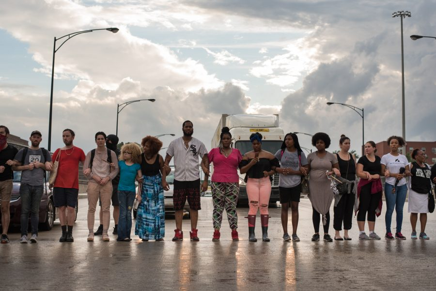 Protesters block traffic on the Dan Ryan Expressway on the city's South Side during evening rush hour in protest of the fatal shootings of two black men by police in Minnesota and Louisiana.