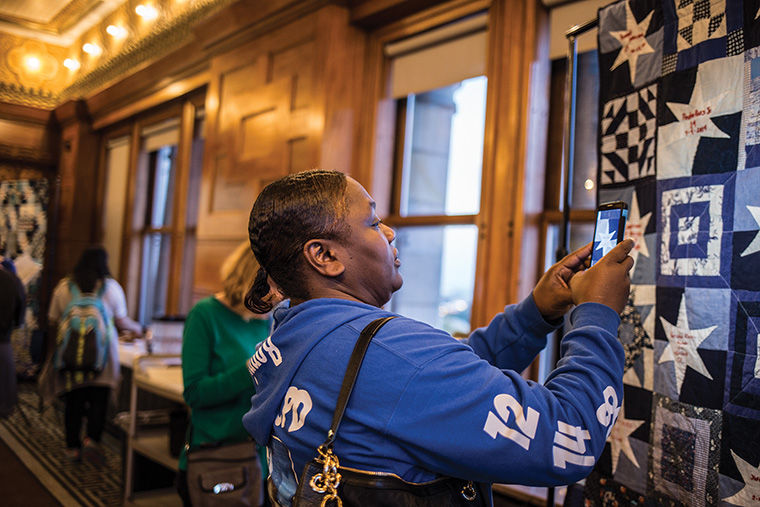 Dorothy Holmes (pictured above) and three other family members of those killed by police spoke at the Oct. 17 exhibit opening for 'Gone But Not Forgotten,' a quilt that honors more than 100 police shooting victims.