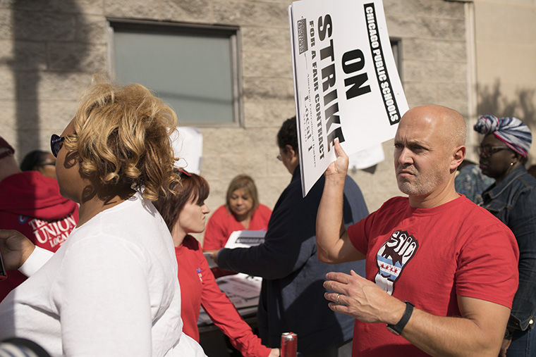 At the Chicago Teachers Union strike headquarters, 1642 W. Van Buren St., teachers handed out signs on Oct. 10 to teachers preparing for the possible CTU strike the following day. The strike never occurred due to a tentative agreement CPS offered CTU minutes before the midnight deadline.