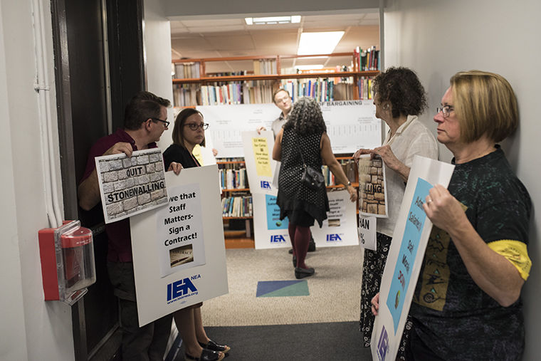 Members of the United Staff of Columbia College picketed outside an Oct. 18 bargaining meeting, held at the 624 S. Michigan Ave. Building, to raise awareness about their lack of a contract.