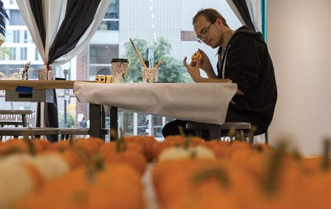 Freshman cinema art + science major Micahel Witek paints a pumpkin Oct. 21 at an event in the 623 S. Wabash Ave. Building as part of the annual WAC Art Crawl celebration.